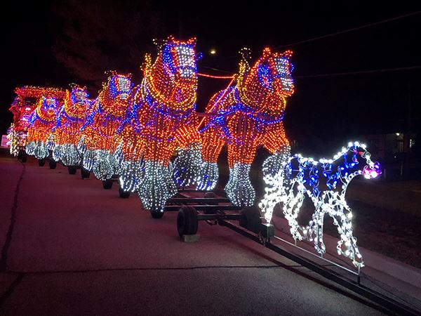Lighted horses and dog parade float