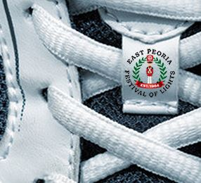 running shoe laces with Festival of Lights logo in the center