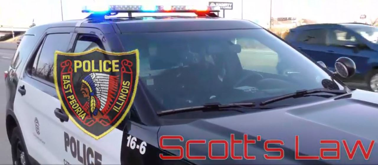 Picture of police car with East Peoria Police logo and words Scott&#39s Law