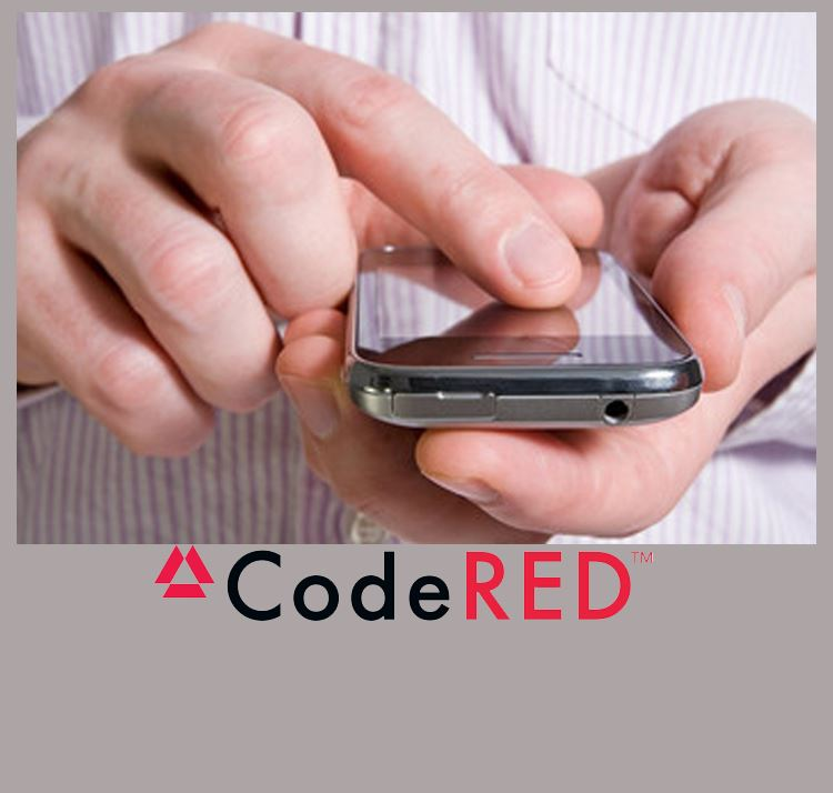 Hands holding cellphone along with words CodeRED