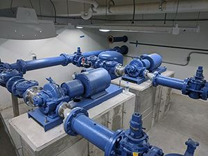 Industrial pipes and pumps inside a building
