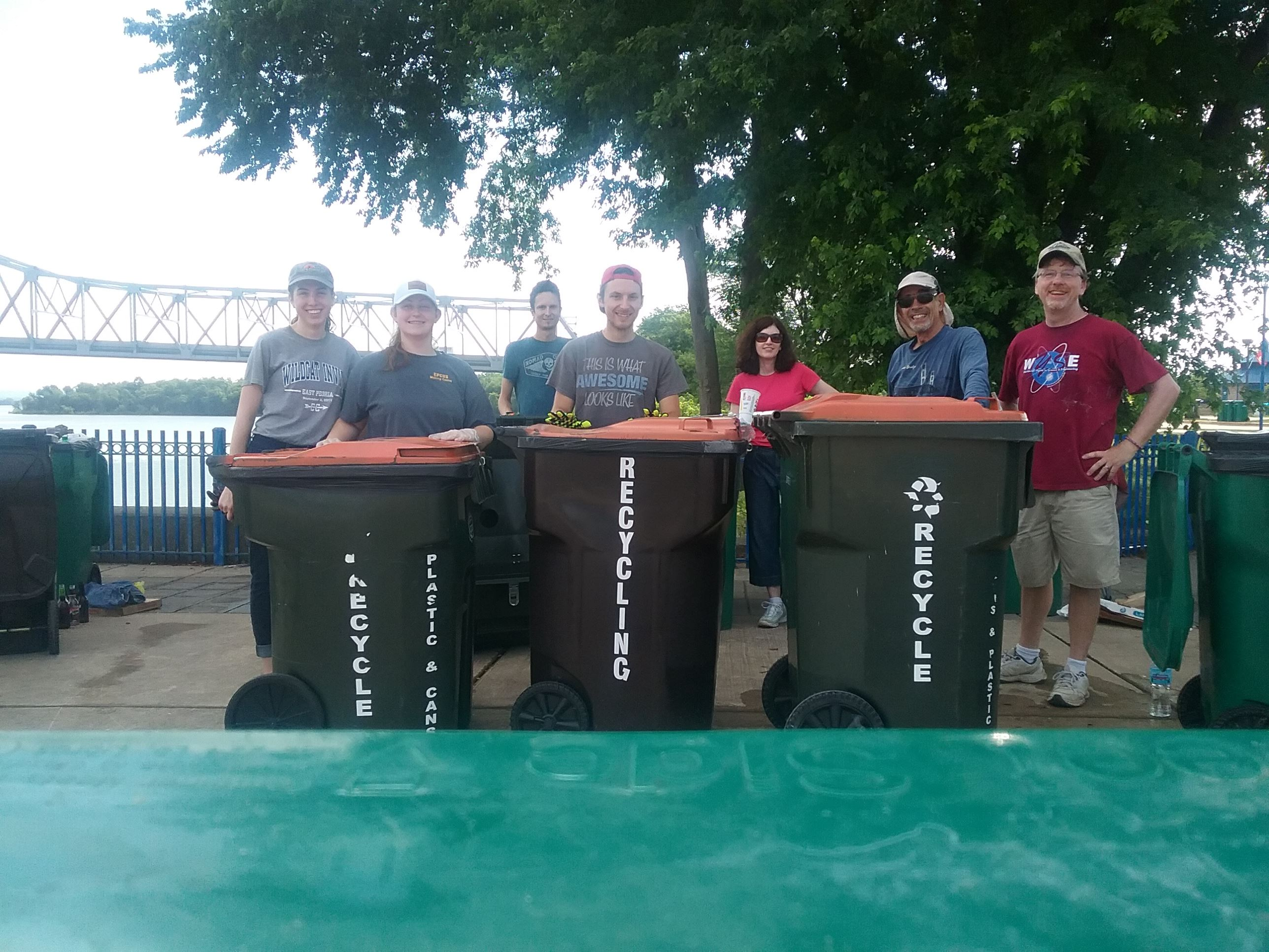 Members of the EP Green Team standing behind recycling bins